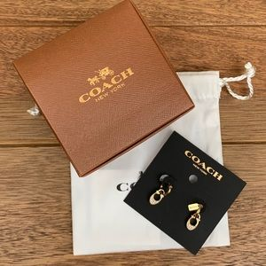 Coach gold colored studded earrings